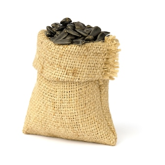 Sunflower seeds in sack bag isolated