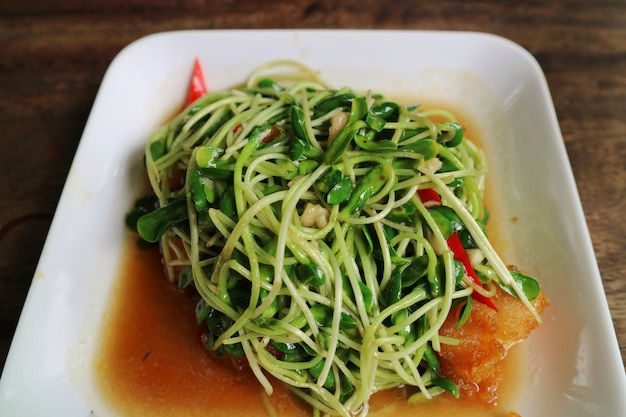 Sunflower sprouts fried with oyster sauce and chili. thai food style. food concept.