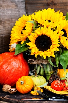 Sunflowers and autumn decorations on wood