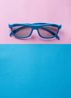 Sunglasses on blue and pink background