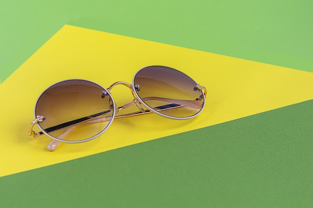 Sunglasses on a colored background. isolate. healthy eyes. copy space.