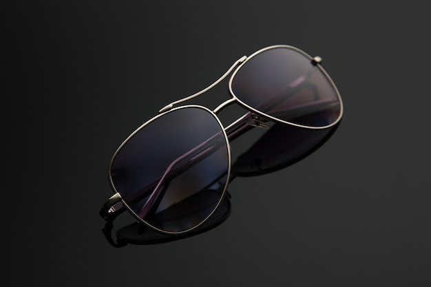 Sunglasses glasses form drop, metal frame for police, pilots, spies, stylish gradient background with polarizing filter.