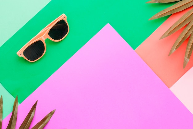 Sunglasses on multicolored surface