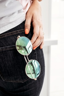 Sunglasses in pocket  concept vacation minimalism city