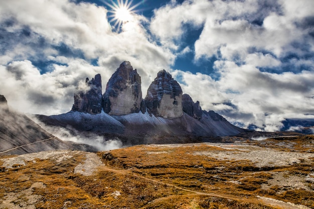 Sunlight on a cloudy day in dolomites with a view of famous tre cime di lavaredo, italy