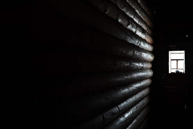 Sunlight coming through the wooden window in an old dark room