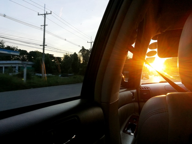 Sunlight through windshield in car in evening time