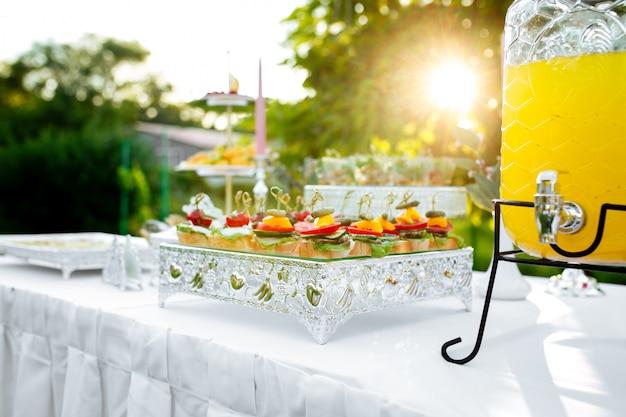 Sunny banquet table tappas canape and lemonade jar