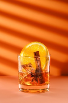 Sunny cocktail with brandy and orange liquor, cinnamon and star anise