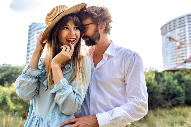 Sunny outdoor fashion image of beautiful magnificent stylish elegant glamour couple