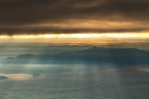 Sunriase with fog, mist and cloud cover the mountain at dawn