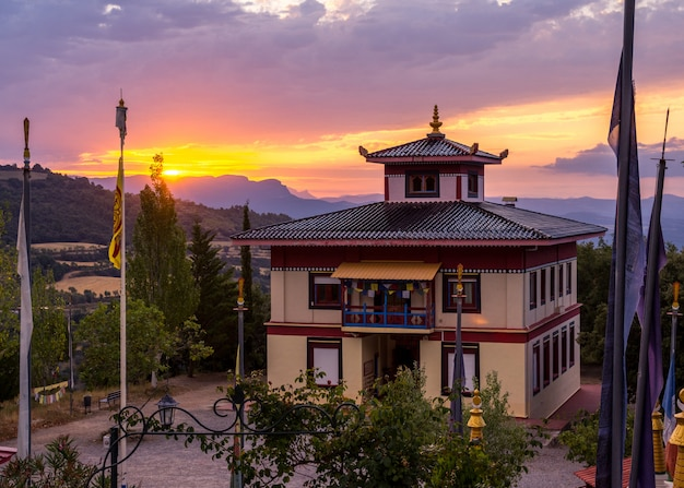 Sunrise in a buddhist temple dag shang kagyu in panillo huesca aragon spain