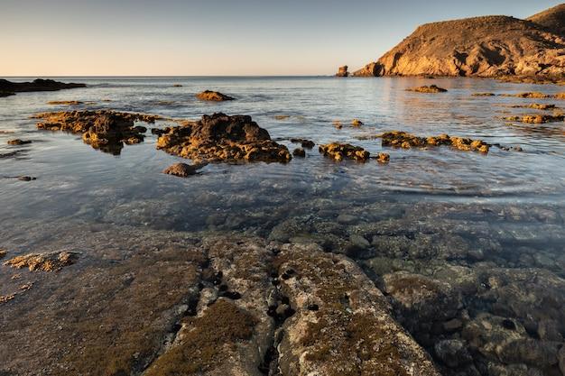 Sunrise on the coast of escullos. natural park of cabo de gata. almeria. spain.