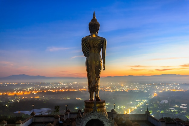 Sunrise, golden buddha statue in khao noi temple, nan province, thailand