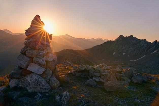 Sunrise high in the mountains, sun's rays shine