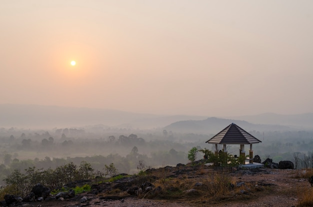 Sunrise over the hills that stretch with pavilion, nakhonnayok thailand