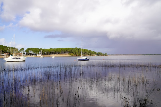 Sunrise lake and boats port hourtin gironde france