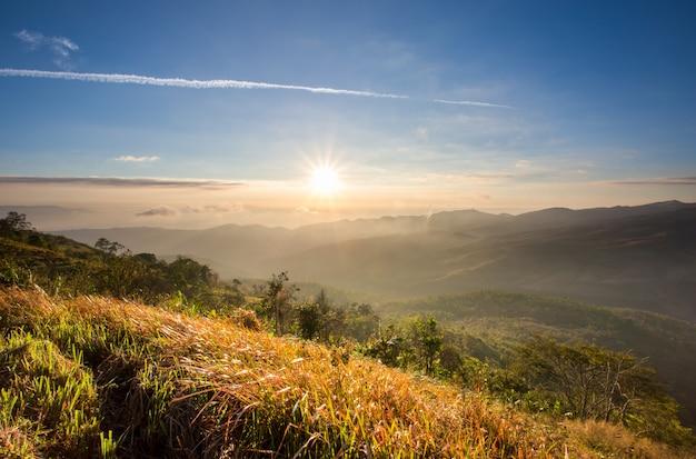 Sunrise on multi layer of high mountain