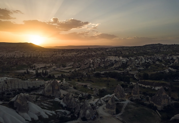Sunrise in national park of cappadocia. aerial view