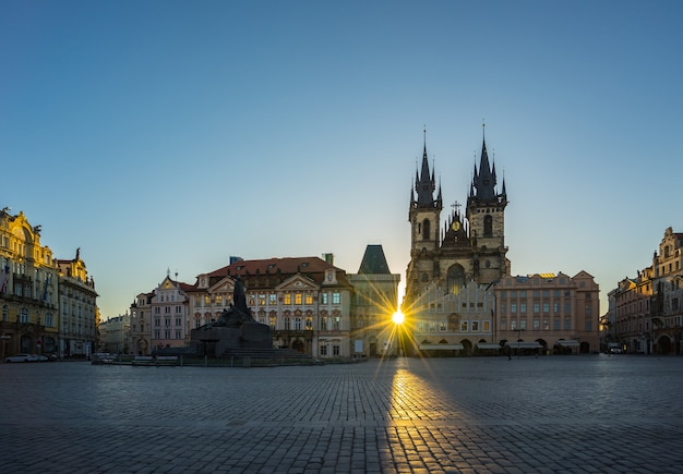 Sunrise in prague old town square with view of tyn church in czech republic