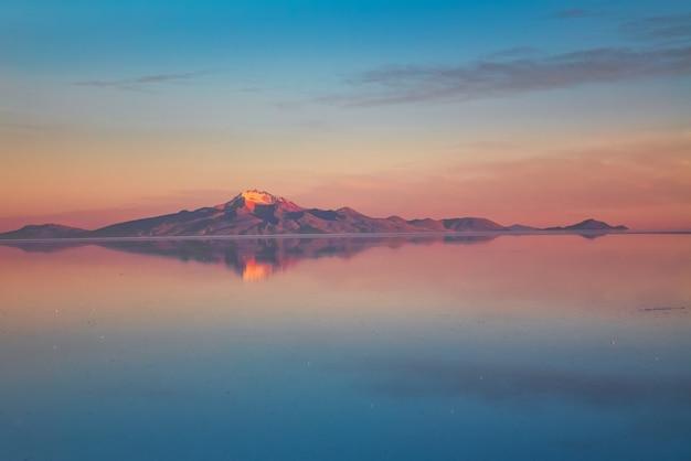 Sunrise on salar de uyuni in bolivia covered with water