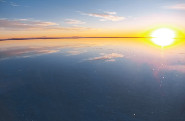 Sunrise on salar de uyuni in bolivia covered with water