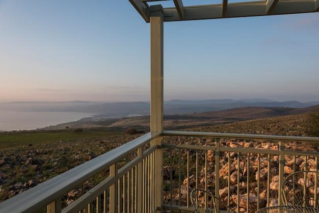 Sunrise over sea of galilee seen from balcony, galilee, israel