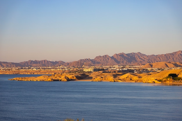 Sunrise over the sinai mountains by the red sea. egypt, sharm el sheikh.