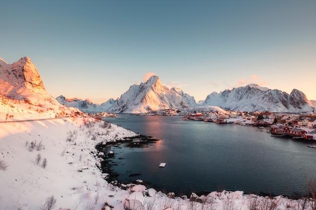 Sunrise on snowy in reine village on winter at lofoten islands