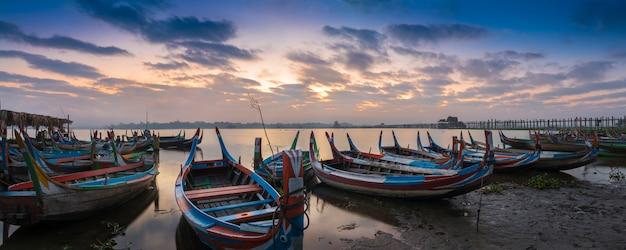 Sunrise at u bein bridge with boats