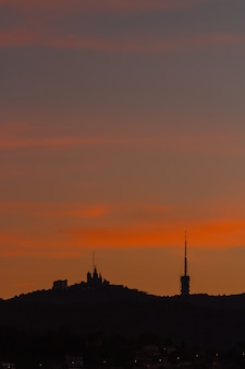 Sunrise view of tibidabo in barcelona. catalonia, spain