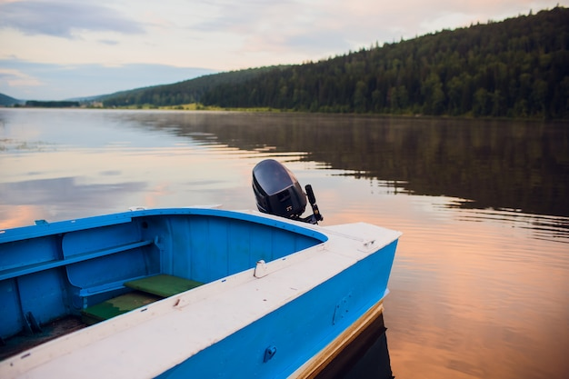 Sunrise with wooden boats on river