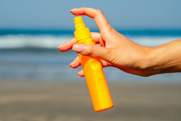 Sunscreen on the background of the beach in asia