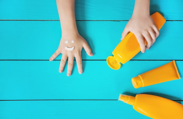Sunscreen on the hand of a child. selective focus.