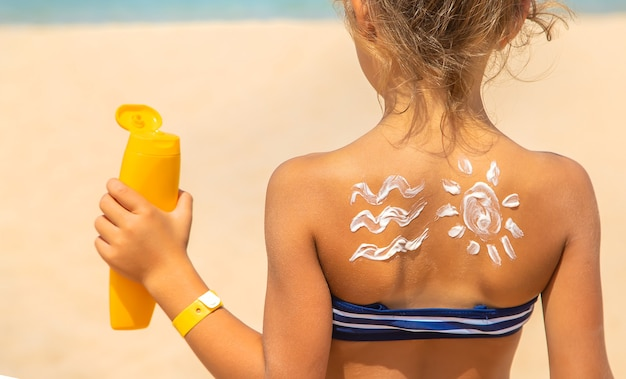 Sunscreen on the skin of a child. selective focus. nature.