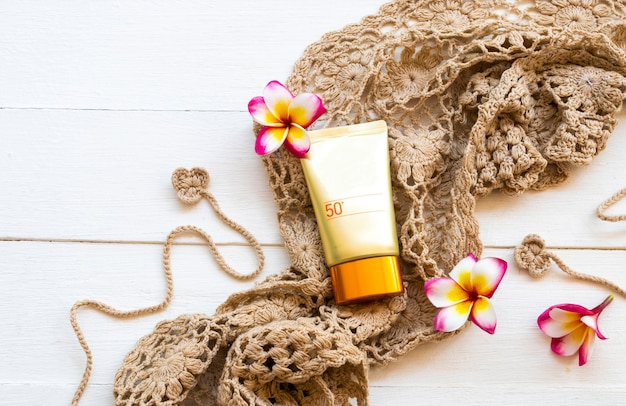 Sunscreen spf50  cosmetics health care for skin face with crochet ,flowers frangipani of lifestyle woman