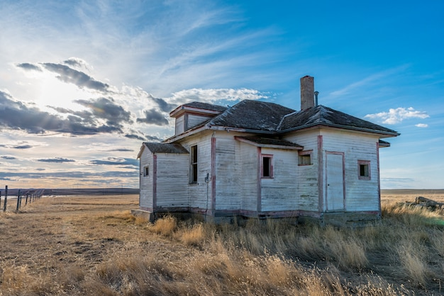 Sunset over the abandoned frenchville one-room schoolhouse in frenchville, sk