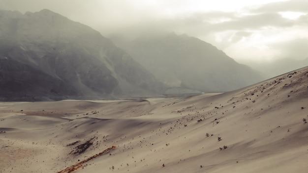 Sunset after sandstorm at the cold dersert. skardu, gilgit baltistan, pakistan.