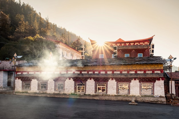 Sunset on ancient building of tibetan temple in autumn