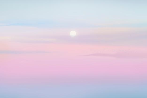 パステルカラーの空に夕日の背景