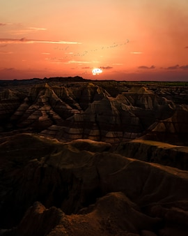 Sunset over badlands. terrain with striped rock formations