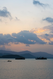 Sunset over the bay with fishing boats.