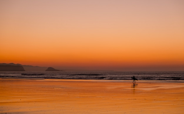 Sunset beach surfer
