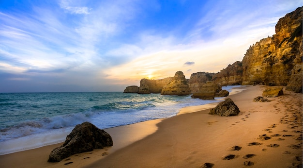 Sunset in beautiful beach praia da marinha