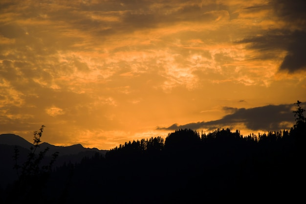 Sunset colored sky, blue, yellow, orange and red, mixed colors,shadows and lights, in europe