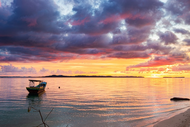 Sunset colorful sky on sea, tropical desert beach, no people, dramatic clouds, travel destination getting away, long exposure indonesia sumatra banyak islands