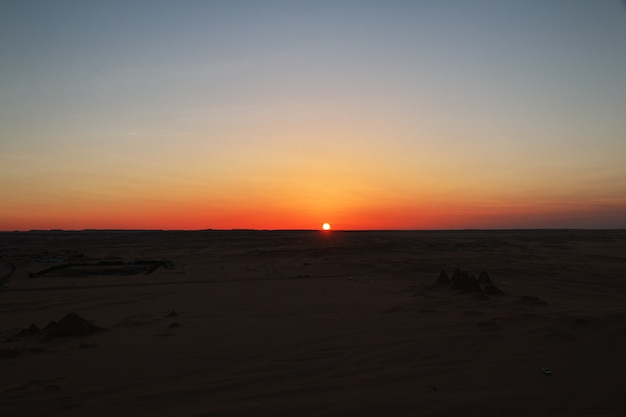 Sunset on desert sahara in sudan