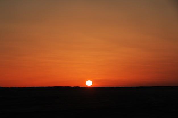 Sunset on desert sahara in sudan