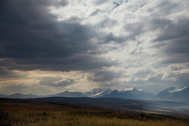 Sunset in the desert, the sun's rays shine through the clouds. ukok plateau of altai. fabulous cold landscapes. no one around