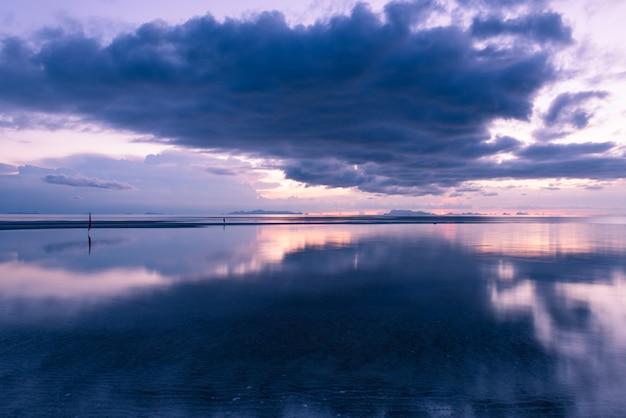 Sunset dramatic  tropical big rain cloud blue sky and sea